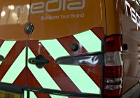 Illuminated chevron and safety equipment to increase roadside safety for delivery professionals